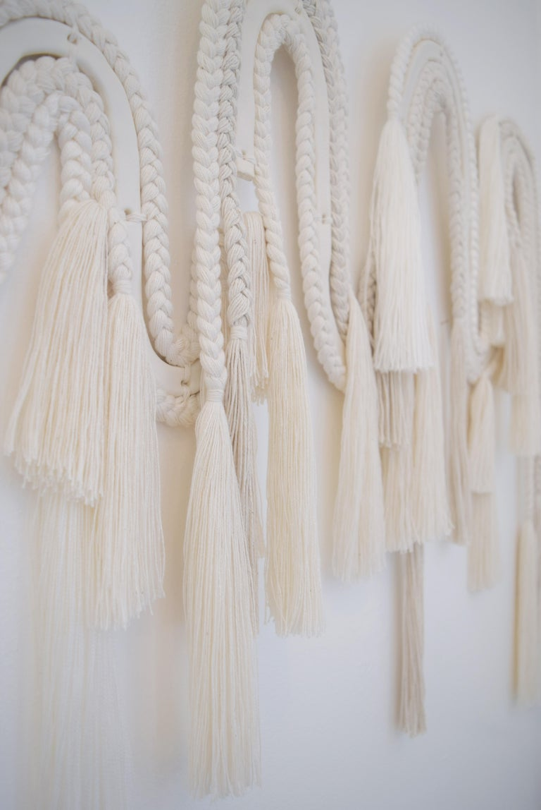 Made to Order Wall Sculpture #613 by Karen Gayle Tinney  Made to order wall sculpture in mixed materials of ceramic and braided cotton/tencel fibers. A ceramic core, glazed in satin white is surrounded by braids in different textures and weights;