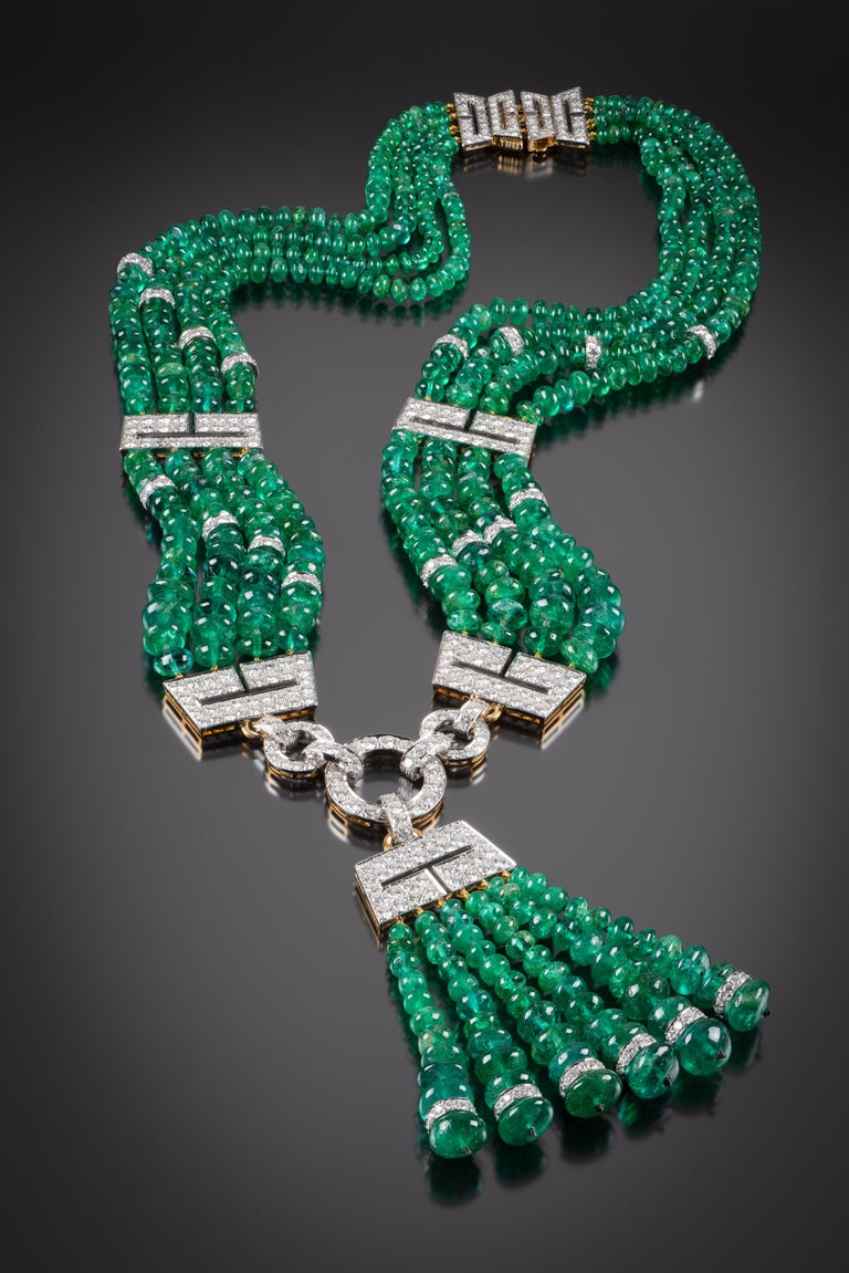 This spectacular David Webb emerald and diamond necklace is one-of-a-kind and authenticated by David Webb.  It is set with four graduated rows of emerald beads, interspersed by open work panels of pave-set with round brilliant-cut diamonds, further