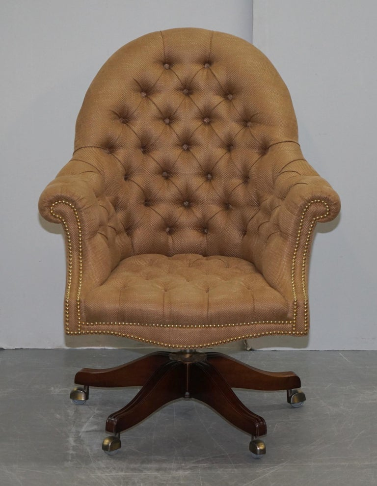 We are delighted to offer for sale this lovely one of a kind Chesterfield button Directors armchair upholstered in plush woven linen 