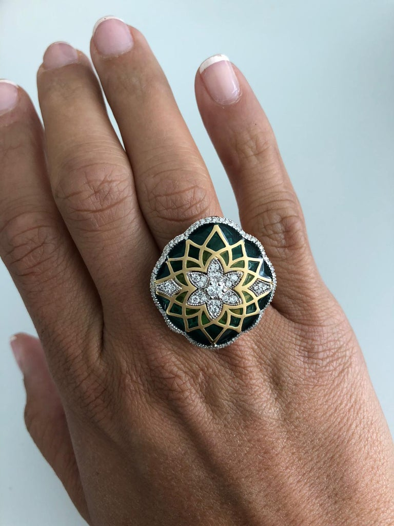 Italian 18K white and yellow gold floral ring featuring a diamond cluster and diamond outline weighing 0.73 Carats with shades of light to dark green enamel. Color F-G Clarity SI A real eye catcher. Ring is sizeable