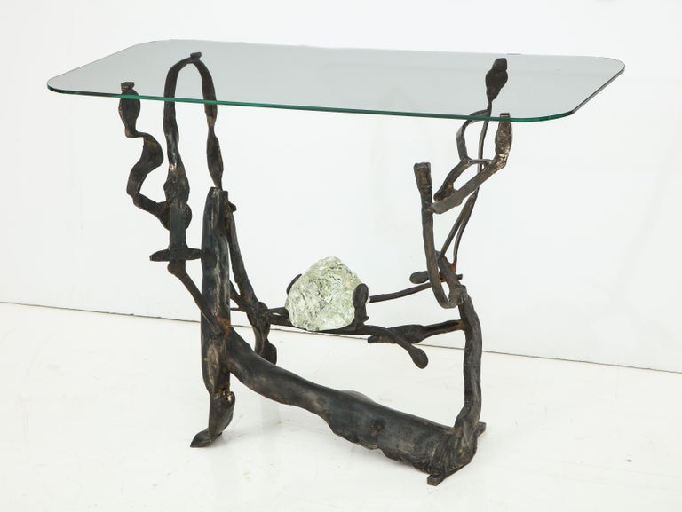 This one of a kind console is true work of sculptural art. Handcrafted in Italy by an artisan in raw iron, this piece is an organic masterpiece. The twisted black iron resembles the twisted branches of a tree (perhaps even a grape vine as this piece