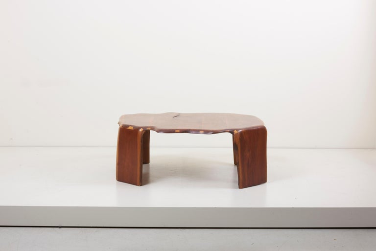 One of a kind James Monroecamp coffee table in walnut. Signed!  James Monroe Camp was a self-taught, African-American artist who began working in wood to fill what he called