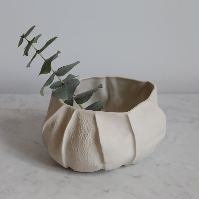 This is a one of a kind Kawa bowl designed and made by Luft Tanaka.  To make this piece: -Luft collected scrap leather and sewed it freeform to make a small bowl-shaped mold. -Liquid porcelain is poured directly into each leather mold. Once