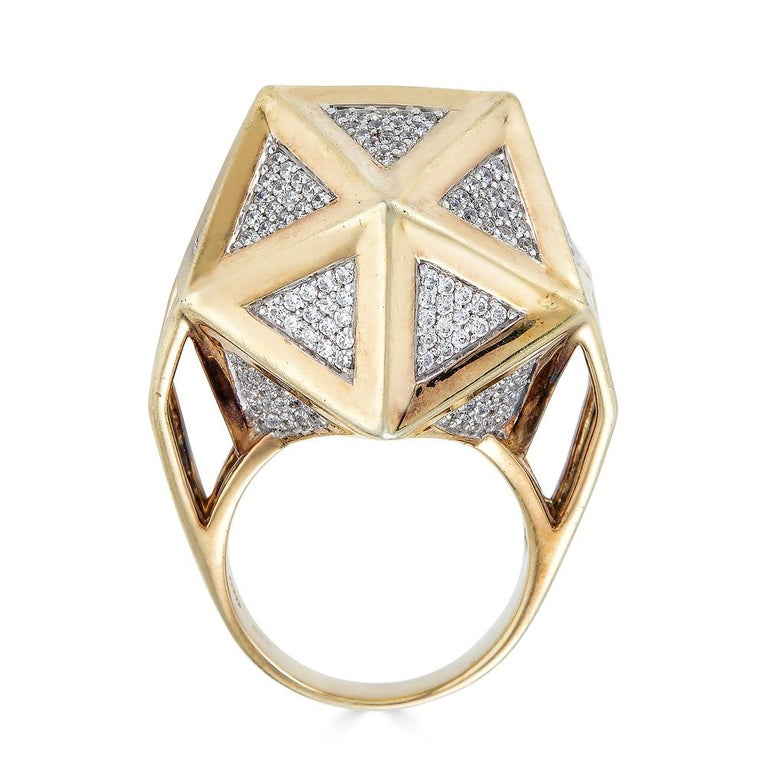 This one of a kind icosahedron ring by John Brevard is inspired by sacred geometry and the platonic solids of ancient philosophers. With twenty equilateral triangular sides fully paved with white diamonds, this icosahedron ring is associated with