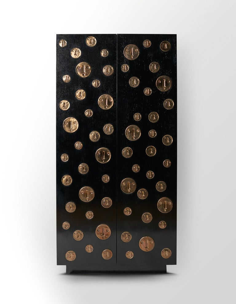 Cabinet or sideboard by Dalo, one of a kind 2018 Varnish black stained oakwood with stylized ceramic medallions with faces in golden enamel.