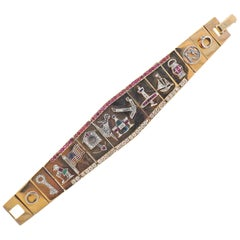 One of a Kind Retro Platinum Gold Diamond Ruby Sapphire Charm Bracelet