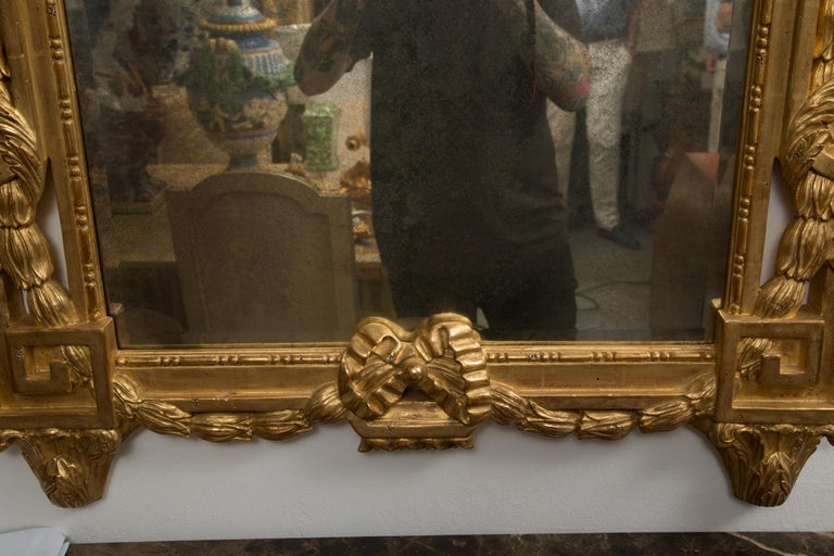 Other One of a Pair of Carved Giltwood Italian Wall Mirrors For Sale