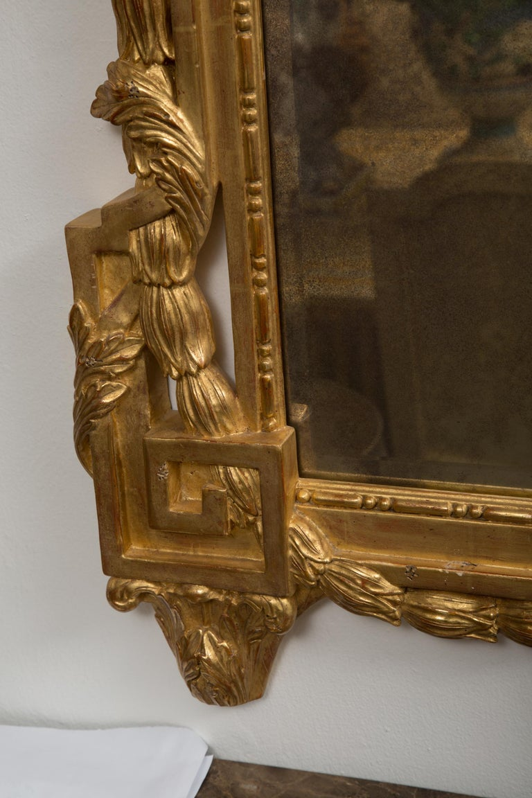French One of a Pair of Carved Giltwood Italian Wall Mirrors For Sale
