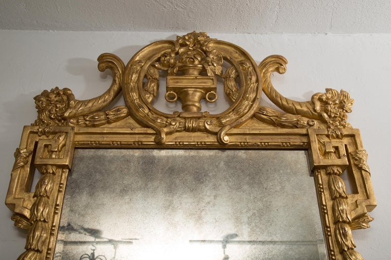 One of a Pair of Carved Giltwood Italian Wall Mirrors In Good Condition For Sale In WEST PALM BEACH, FL