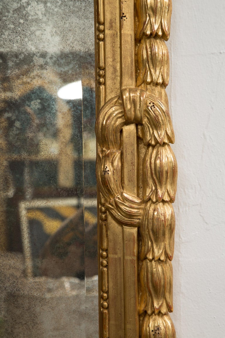 20th Century One of a Pair of Carved Giltwood Italian Wall Mirrors For Sale