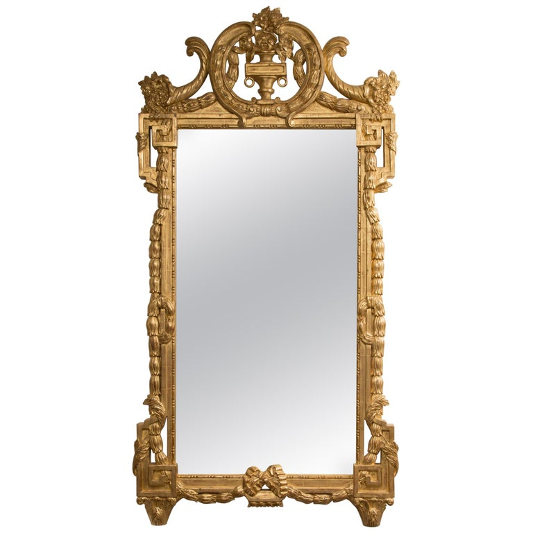 One of a Pair of Carved Giltwood Italian Wall Mirrors For Sale