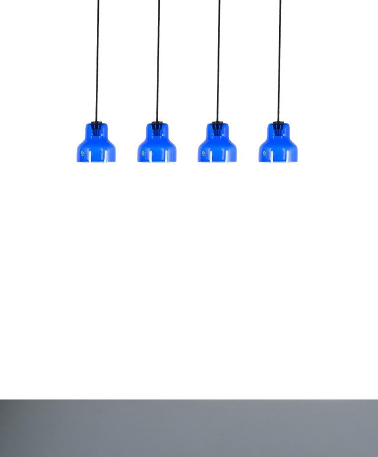One of five blue Murano glass pendant lamps, circa 1980. Priced per item. Beautiful Italian pendant lights from blue Murano glass. They are in good condition with no chips to the glass shades. Perfect for being placed over a kitchen island.