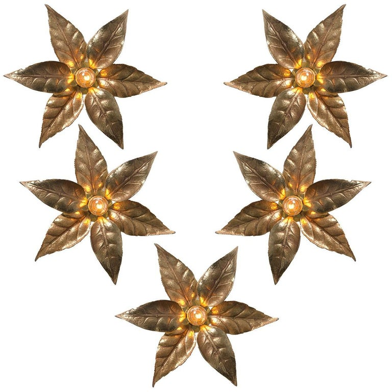 Of five brass flowers wall lights in the style of designer Willy Daro manufactured by 'Massive Lighting', circa 1970s, Belgian. This decorative and beautiful large sculptural light consists brass-plated flowers on a circular base of the same finish.