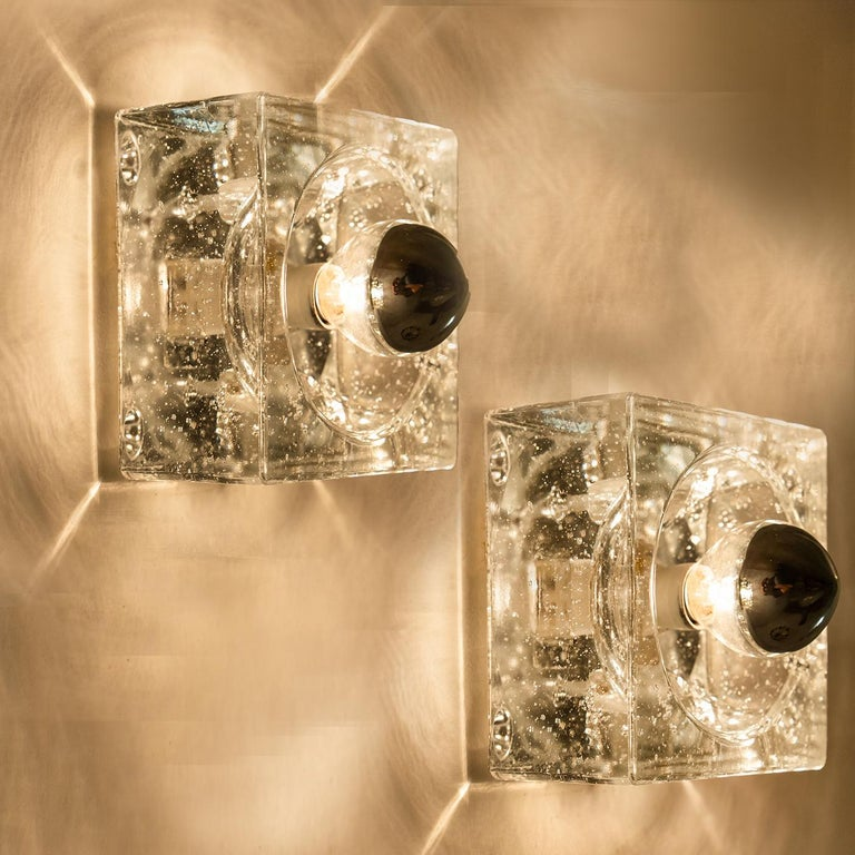 This lights are made from thick hand blown glass on a square silver colored backplate. The glass causes a nice lighting effect on the ceiling, table or wall. Each lamp has an E14 fitting (max 25 watt) and it is possible to have a (pull) switch.