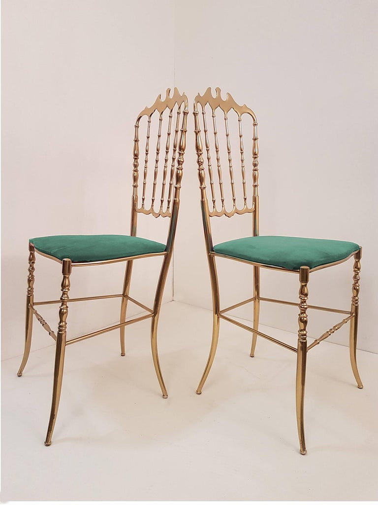 Set of refined Italian Campanino Classic Chiavari chairs, circa 1950s. Massive brass with upholstered with beautiful emerald green velvet.  The price is for the one item. Sold superlatively, in pairs or as a set. In very good condition.