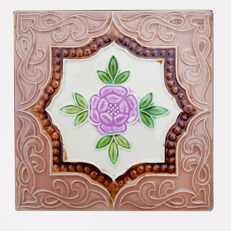 This is an amazing set of antique Art Deco handmade tiles. A beautiful relief and color. These tiles would be charming displayed on easels, framed or incorporated into a custom tile design.  Please note that the price is for one piece. We sell them