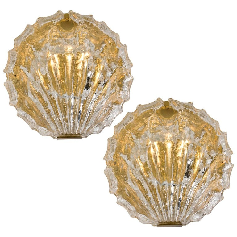 Pair of very exclusive wall lights by J.T. Kalmar handmade and very heavy quality. Each sconce is made of polished brass frames with a large crystal glasses in the form of a shell. Illuminates beautifully.
