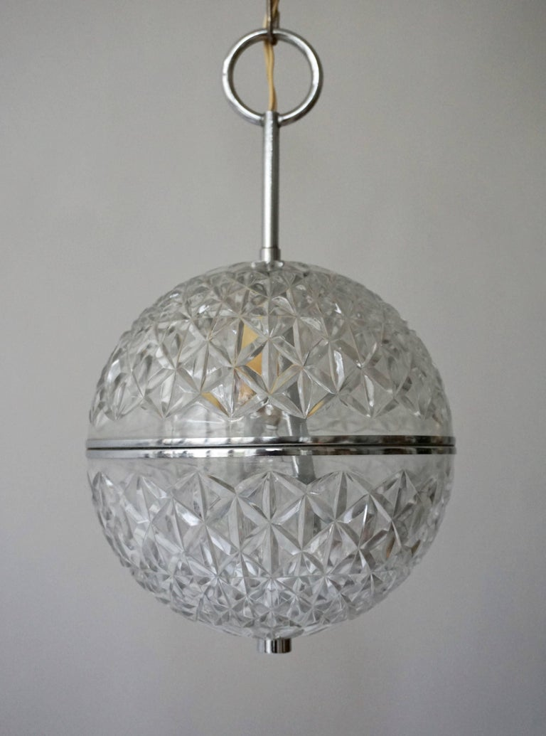 Mid-Century Modern One of Two Crystal Glass and Brass Globe Pendant Lights For Sale