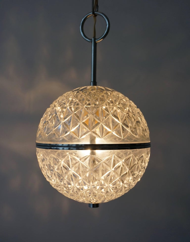 Italian One of Two Crystal Glass and Brass Globe Pendant Lights For Sale