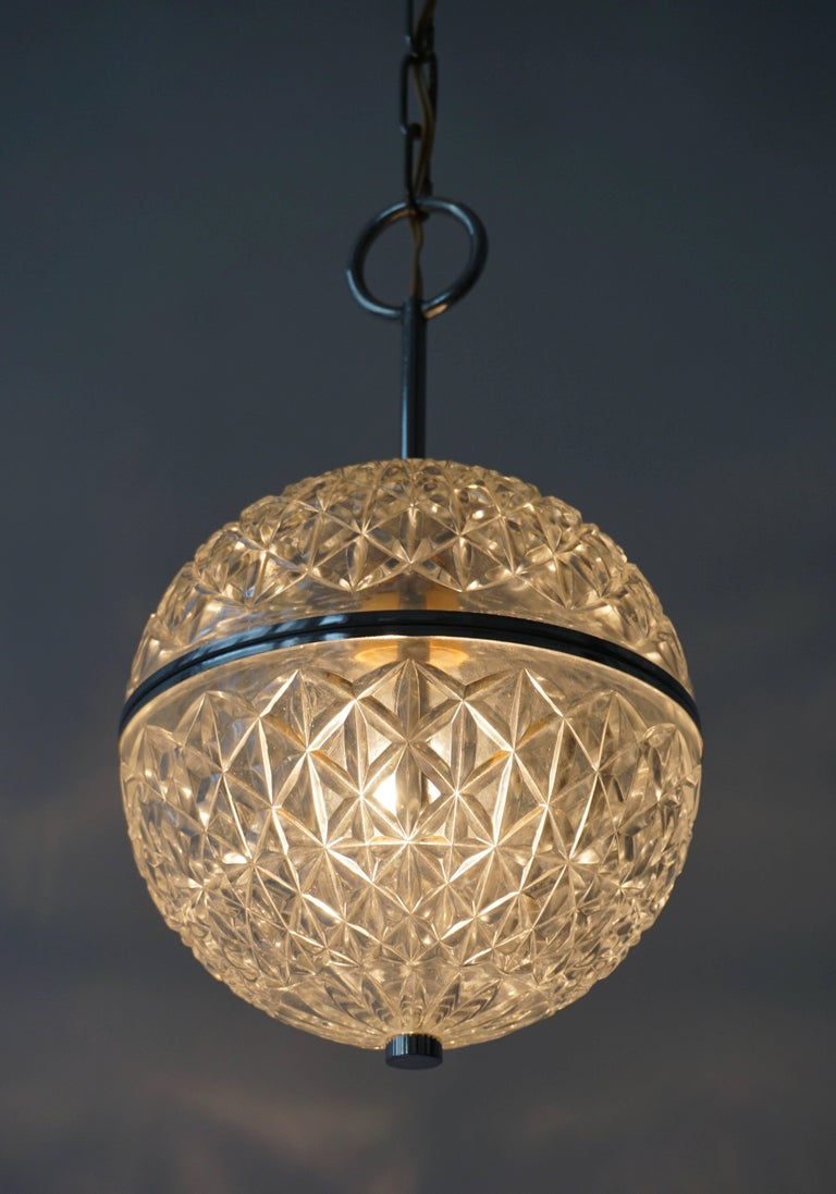 20th Century One of Two Crystal Glass and Brass Globe Pendant Lights For Sale