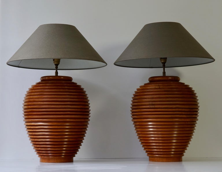 Two beautiful old antique wooden stock pots from Burma converted in the 1970s into lamps.