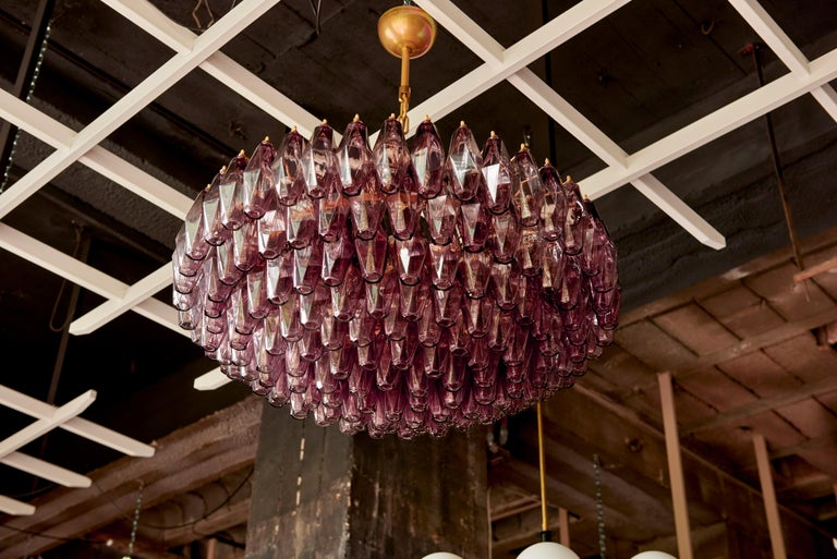 Very huge hand blown amethyst Murano glass poliedri or polyhedral chandelier in the manner of Carlo Scarpa for Venini. The chandelier has an impressive size and is in very good condition. 2 pieces available.