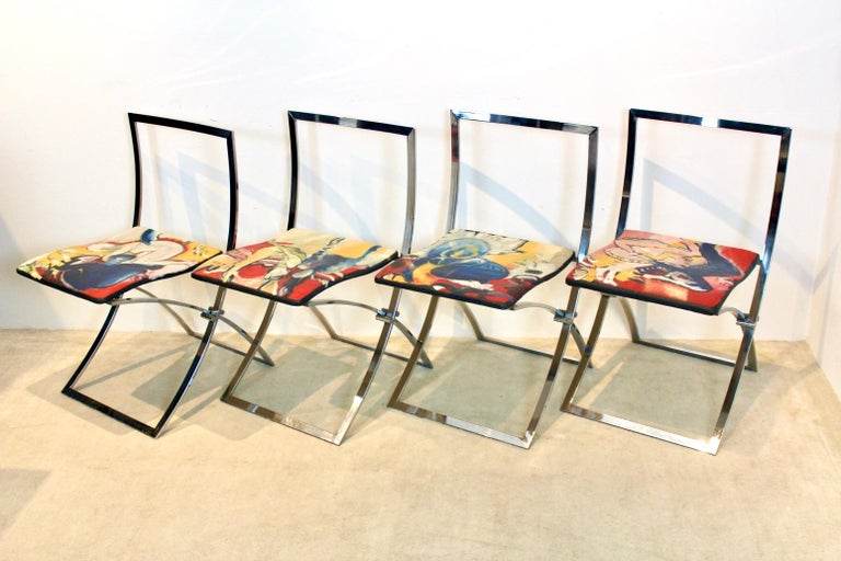 Exquisite set of four 'Luisa' dining chairs designed by the Italian architect Marcello Cuneo in the 1970s and manufactured by Mobel Italia. This is a unique and one off set where the upholstery is painted in the 1990s by a modernist painter