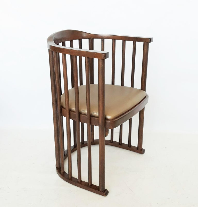 A fine find! These barrel armchairs model No. 729/2F, designed by Josef Hoffmann, circa 1906. The simplicity of this chair design: is made up of a u-shaped horizontal rail that forms both the armrest and the crest rail. Supported by evenly spaced