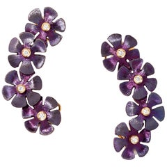One Pair of Floral Earcuffs Set with Diamonds in 18K White Gold and Titanium