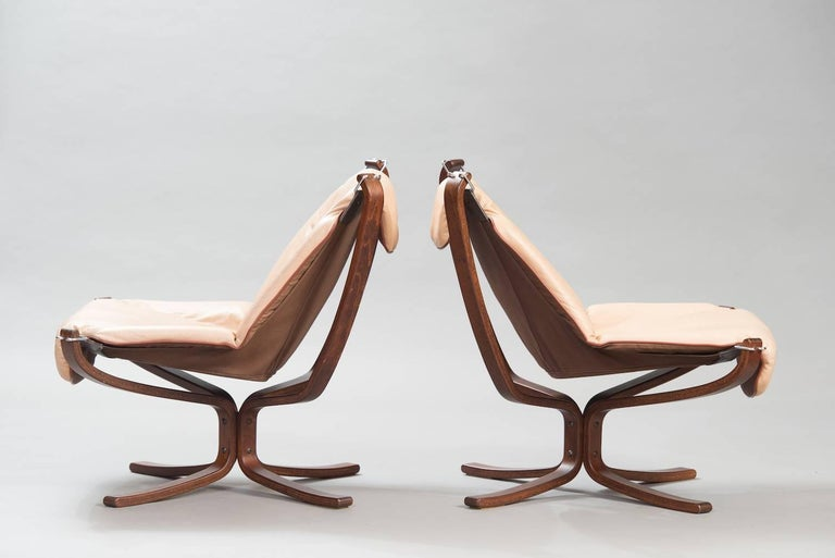 "One pair of beige leather ""Falcon"" chairs."