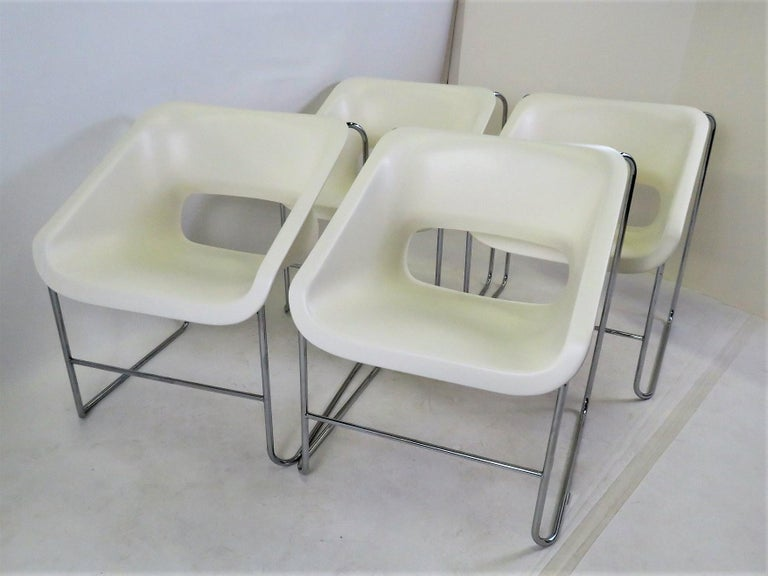 Set of 4 Space Age Mid-Century Modern armchairs created by Paul Boulva for the Montreal Olympics in 1976 and produced by Artopex of Canada. The chairs sport a chromed metal frame with molded plastic seat. They are stackable. Stamped on bottom of