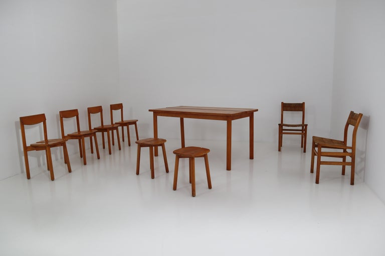 Table and chairs by Pierre Gautier Delaye. Table, set of four chairs, set of two chairs, set of two stools made in France in 1960 from VVF beech massive. The assembly is assembled according to the tenon-mortise principle, visible on the seat. The