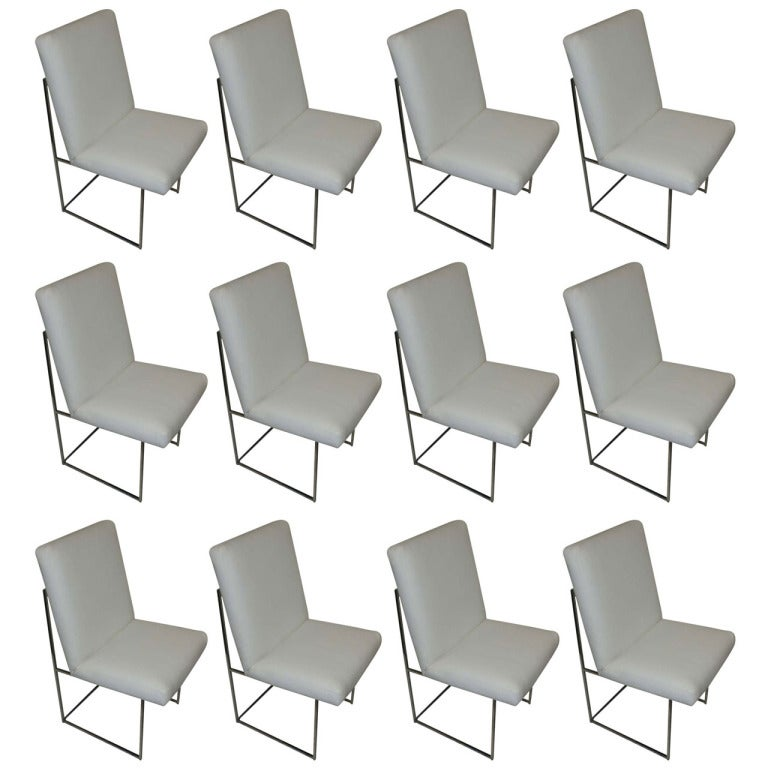 Mid-Century Modern Thin Series dining chairs designed by Milo Baughman. Newly reupholstered in white leather with chrome frames.