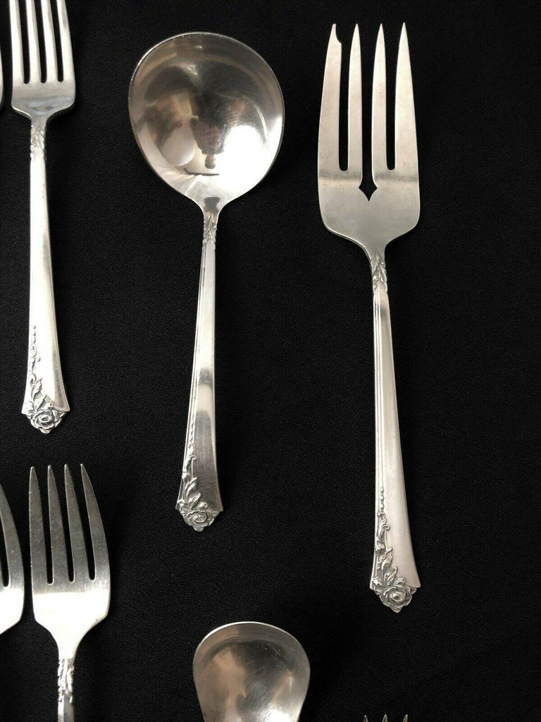 Oneida Heirloom silver, sterling silver flatware service in the Damask Rose pattern. 