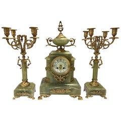 Onyx and Ormolu Bronze Three-Piece Garniture Set, Clock, Candelabras, Pair