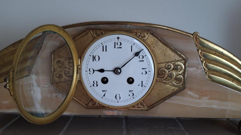 Onyx and bronze Art Deco clockset, France, circa 1925. Movement running, bell striking and keeping time quite well.
