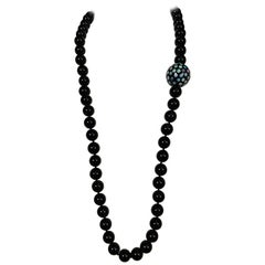 Onyx Bead Necklace Featuring an Australian Opal Studded Large Onyx Bead