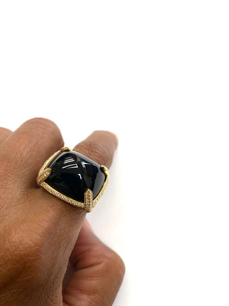 Onyx East-west Cabochon Ring with Diamonds in 18k Yellow Gold, from'Rock N Roll' Collection  Stone Size: 20 x 17 mm  Gemstone Weight: 28.01 Carats  Diamond: G-H / VS, Approx Wt: 1.17 Carats