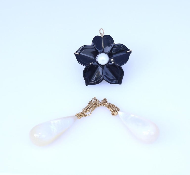 Onyx flower with two detachable Mother-of-pearl pendants. 14K Gold.  1930. Really fine and stylish item. It can be worn as a brooch or as a pendant. There is a special loop on the back for the chain. Can be separated from the two mother-of-pearl