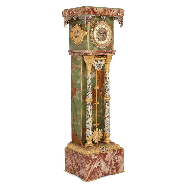 This colorful pedestal clock has been crafted from fine red marble and green onyx, and beautifully decorated with gilt bronze (ormolu) and champlevé enamel. While a popular crafts material in ancient times, onyx was largely forgotten about until its