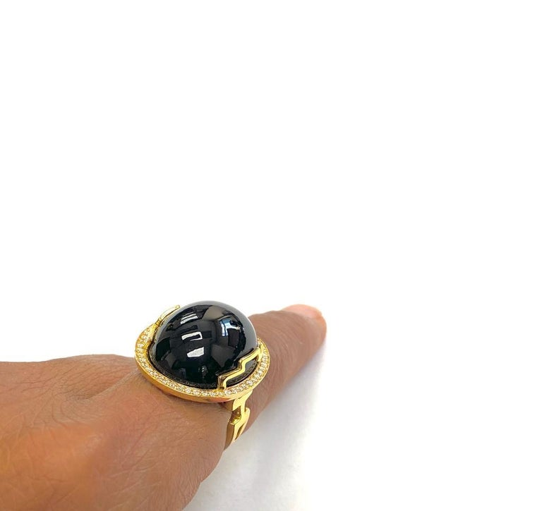 Onyx Oval Cabochon Ring with Diamonds in 18k Yellow Gold, from 'Rock N Roll' Collection  Stone Size: 20 x 17 mm  Gemstone Weight: 24.66 Carats  Diamond: G-H / VS Approx Wt: 0.28 Carats