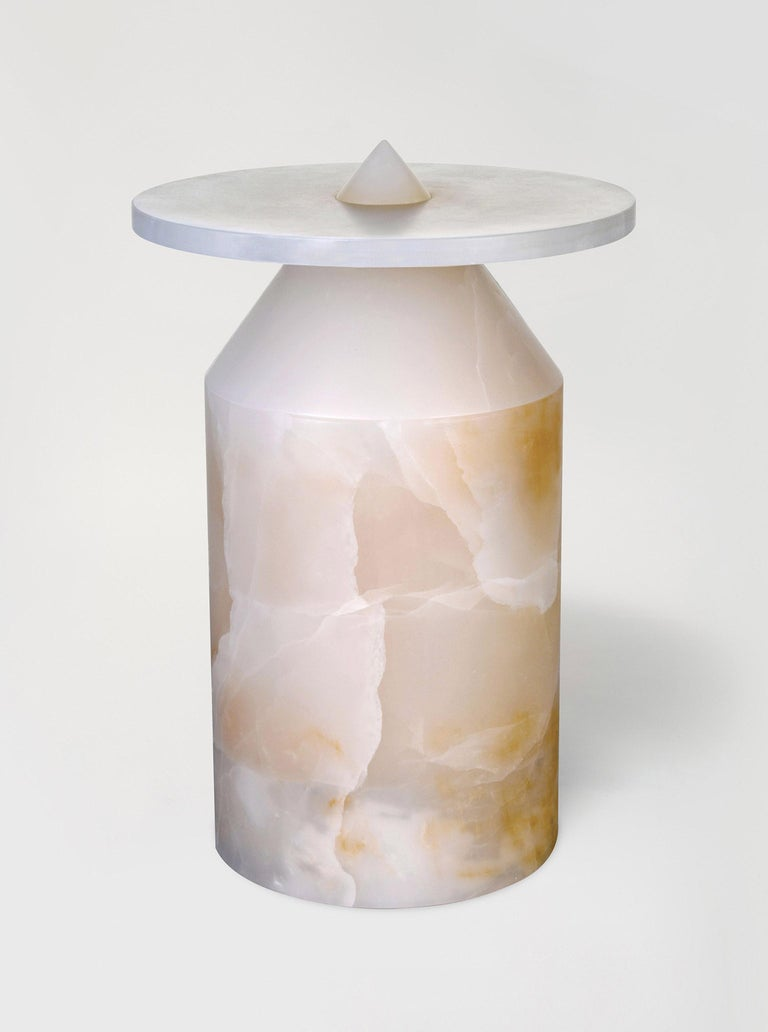 Onyx Totem coffee table, limited edition by Karen Chekerdjian Dimensions: 42 x 42 x 62 cm Materials: White onyx  Karen's trajectory into designing was unsystematic, comprised of a combination of practical experience in various creative fields