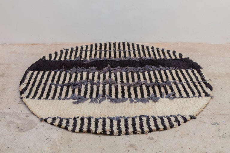 Scandinavian Rya rug designed in the 1960s circular rug by Højer Eksport Wilton modernist round rug in wool and hand knotted. Black and white stripes with blue tufted accents. Dimensions: 170 cm.