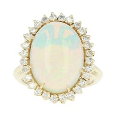 Opal and Diamond Halo Cocktail Ring, 14 Karat Yellow Gold Cabochon 8.66 Carat