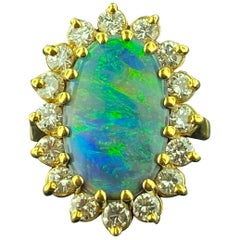Opal and Diamond Ring in 18 Karat Yellow Gold
