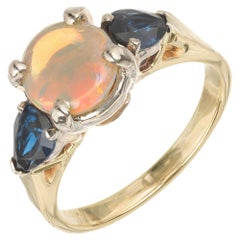 Opal Blue Sapphire Two-Tone Gold Three-Stone Engagement Ring