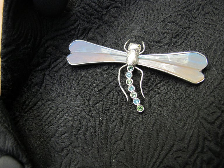 This giant dragonfly pin has a wing span measuring 3 1/4 inches!  The wings were carved by Heinz Postler of Idar-Oberstein, Germany from our rough opal. The opal is from the Mintabie Mine in Australia. It has a light grey base color with faint blue