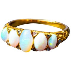 Opal Five-Stone with Diamond Points in 18 Carat Yellow Gold