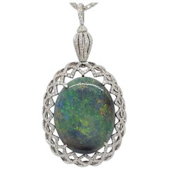 Opal Oval Cabochon and White Diamond Pendant Necklace in Platinum and 18 Karat