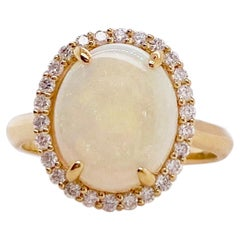 Opal Ring with a Diamond Halo Set 2.82 carats total weight gemstones Yellow Gold